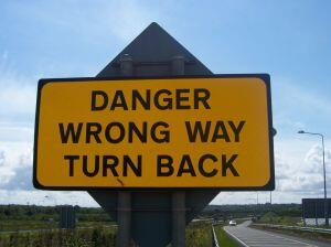 danger wrong way turn back sign