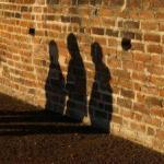three shadows on the wall