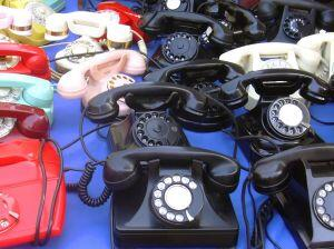lots of telephones on a table