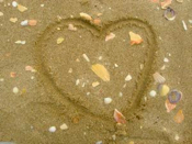 love heart drawn in the sand