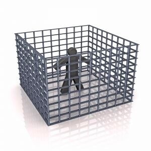 person isolated within a cage