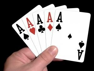hand holding 5 aces