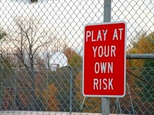 play at your own risk sign