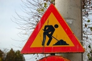 man digging sign