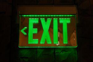 lit green exit sign