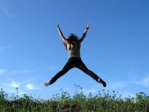 woman jumping in the fields