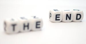 dice spelling out the end