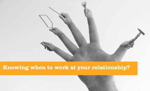 knowing when to work at your relationship - hand with tools on it.
