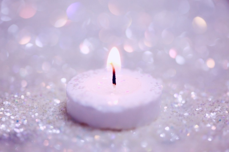 sparkly candle to make a wish | Photo by Sharon McCutcheon on Unsplash